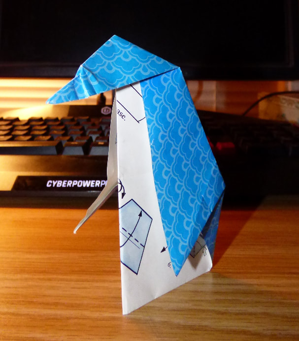 Blue origami penguin, side view