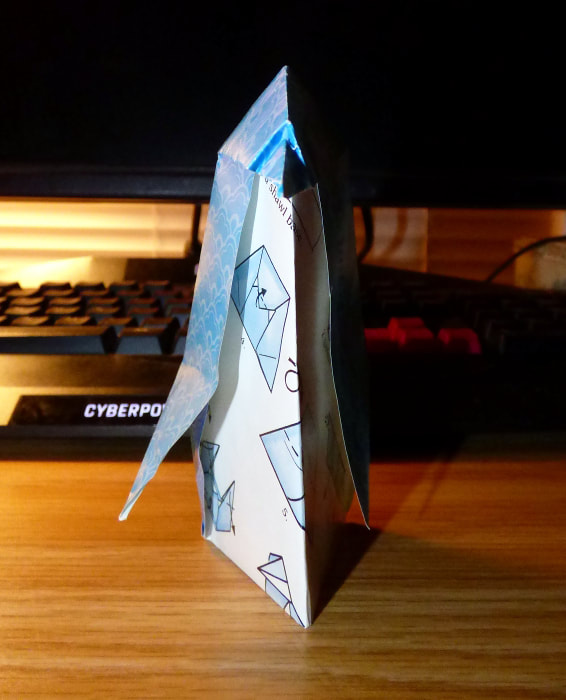 Blue origami penguin, front view