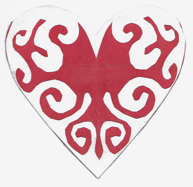 Laminated cut-paper heart-shaped envelope