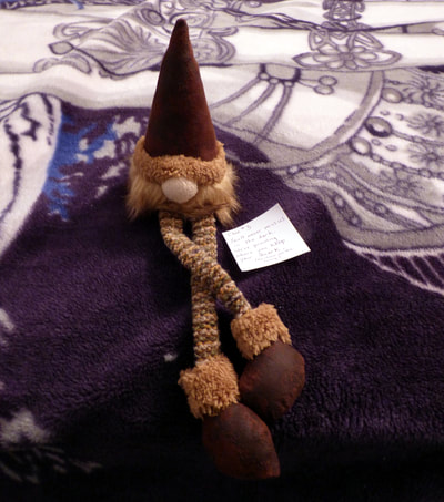gnome plush and clue #3, on guest bed