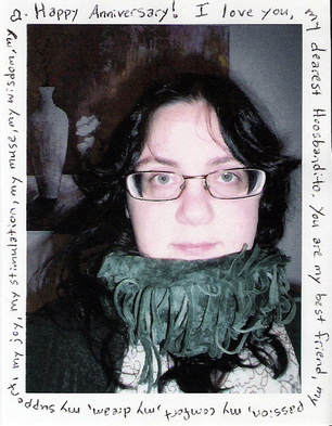 photograph of me bundled up in the scarf he hates, yet is still romantic because I bought it the weekend he proposed. It is ringed by the text